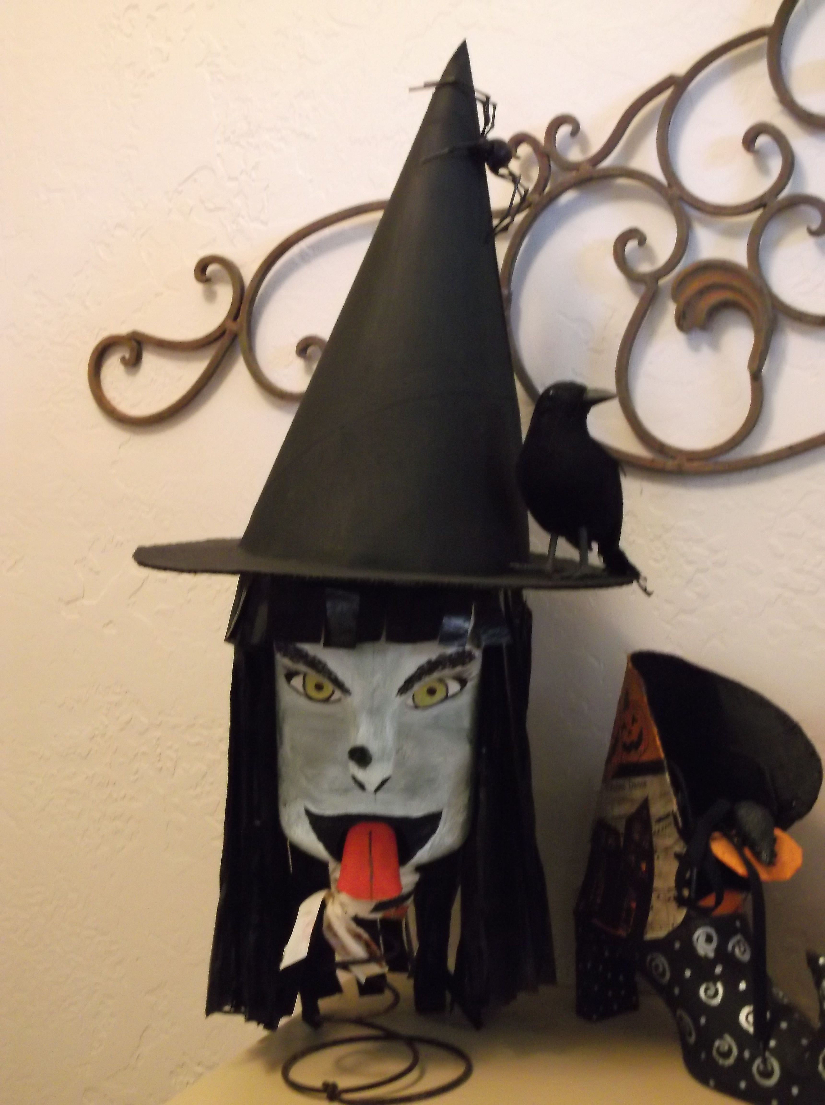 I made this witch out of a plastic milk jug. She has trash bag ...