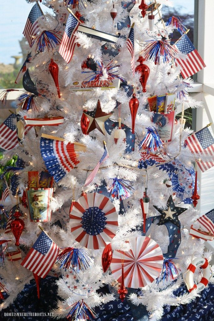 Patriotic Tree on the Porch for Independence Day -  Patriotic Tree with nautical ornaments for the celebration of Independence day | ©homeiswheretheboatis.net #patriotic #tree #redwhiteandblue #porch #