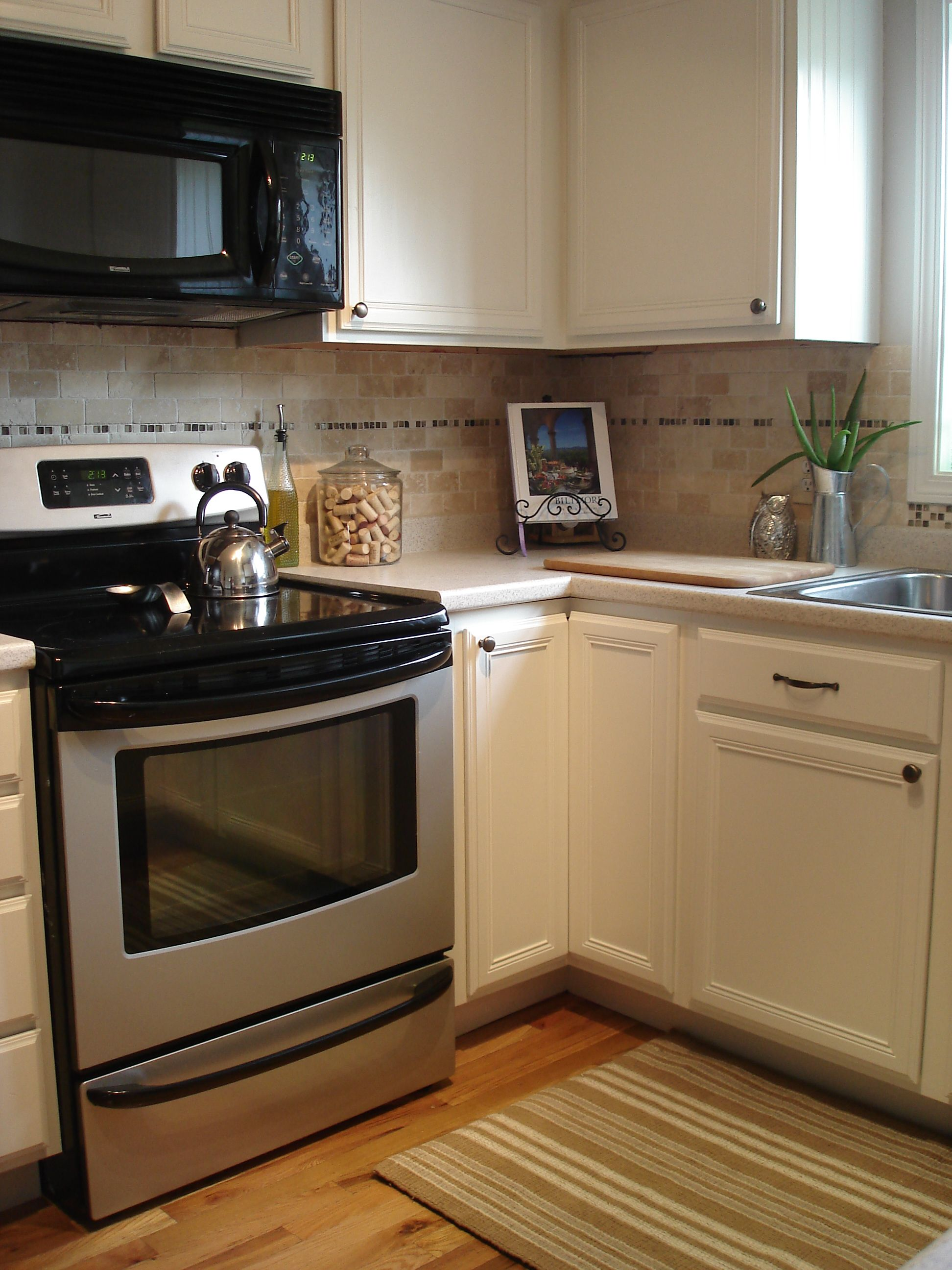 Pin By Candice Startzman On Our First Home Painting Fake Wood Old Kitchen Cabinets Kitchen Cabinets Makeover
