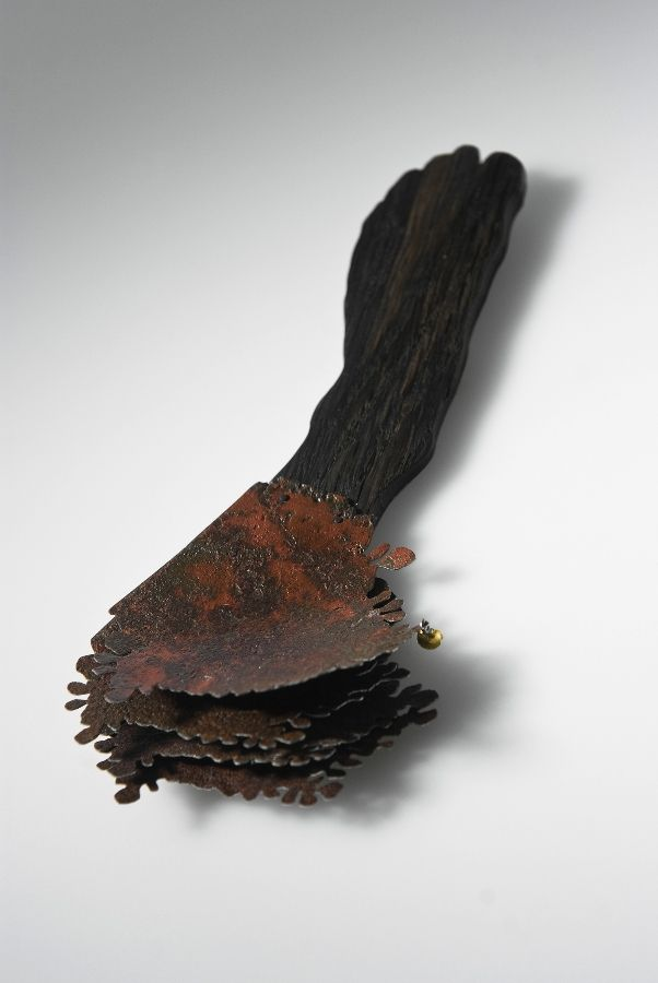 """""""Guesthouse"""". 2011 by Maria Valdma. Black oak, old roof plate, gold, silver."""