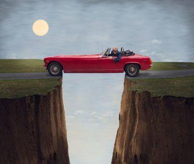 Фото Мужчина в красном автомобиле стоит над пропастью, by ...