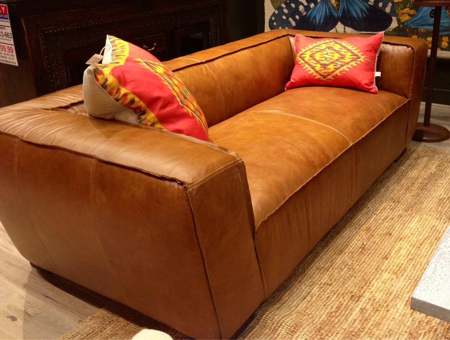 A beautiful leather sofa can be dressed up with print and ...