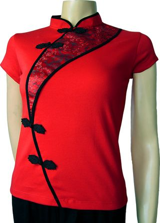 CHINA RED: Oriental allure comes in a snug-fitting, fashionable, sexy Chinese woman's top in China red with red silk brocade.