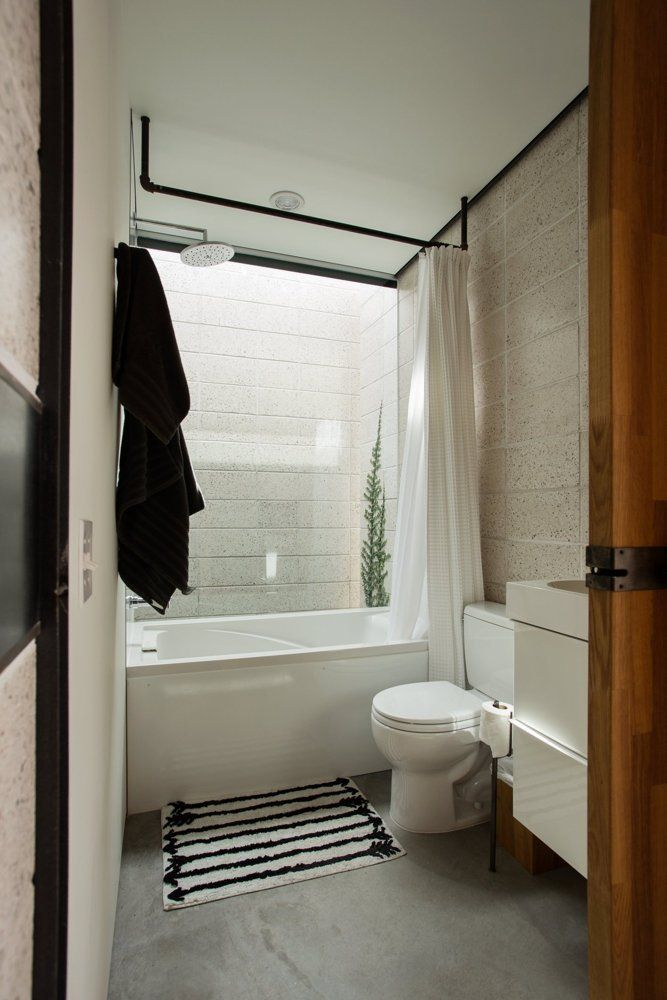 A Small Sophisticated 468 Square Foot Urban Arizona Studio Modern Shower Curtains Bathroom Remodel Shower Bathtub Small Bathroom Remodel