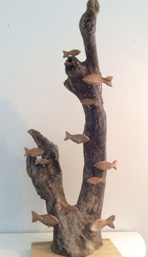 Photo of Beautiful item, assorted sizes of side carved driftwood fish swim around a driftwood reef. Truly ori
