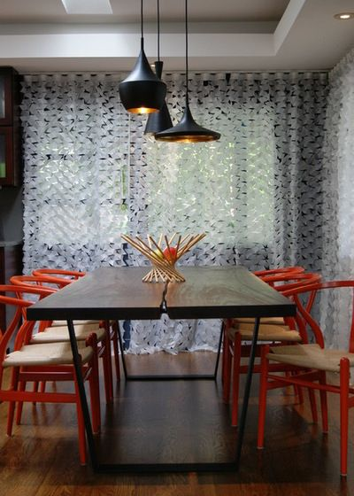 Modern Dining Room with red wishbone chairs and different shaped