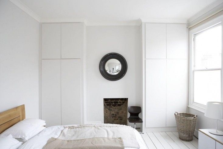 Victorian house in Stoke Newington, London | Remodelista floor-to-ceiling cupboards, painted white to match the walls