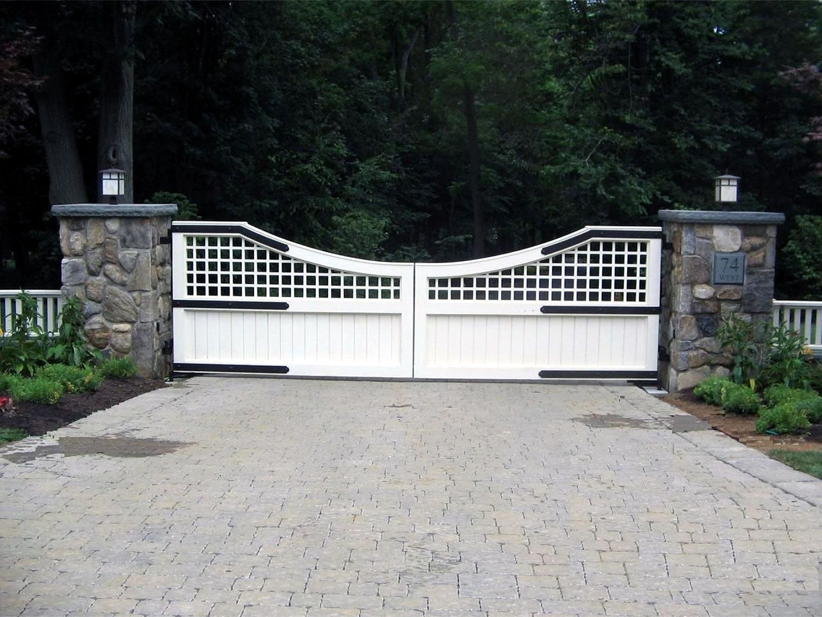 A wooden entrance gate with a transitional design. Scallop curve and ...