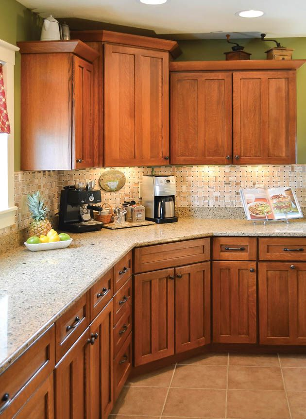 Pale green walls and under cabinet lighting add character for Kitchen design ideas with oak cabinets