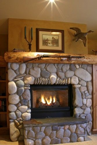 Nothing like a fireplace with your rifle mounted over it o  Cozy by the Fire Place  Log