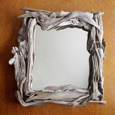 you can attach small pieces of driftwood to a mirror frame