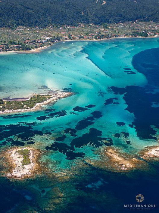 Crystal clear cobalt and turquoise waters in Halkidiki, Greece