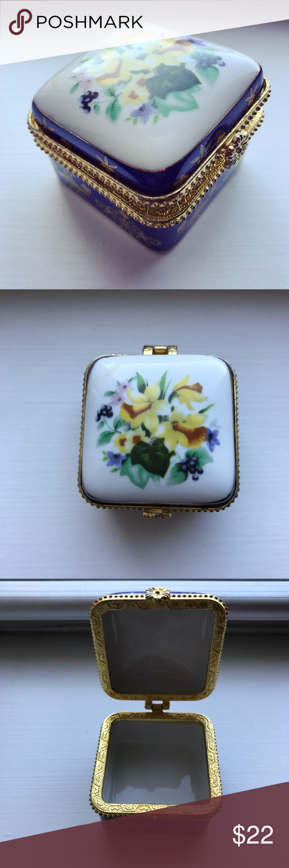 Vintage gold & blue floral jewelry / pill box Vintage white ceramic jewelry / pill box with gold tone trimming and hardware (clasp and hinge). The box is square with rounded edges, and has a rounded top that is white with a floral pattern of yellow, green, pink, and purple. The sides of the box are blue and have gilded gold ornate designs on them. The inside of the box is white. The box is perfect for holding small items, like earrings or pills. It measures 1.65 inches by 2 inches by 2…