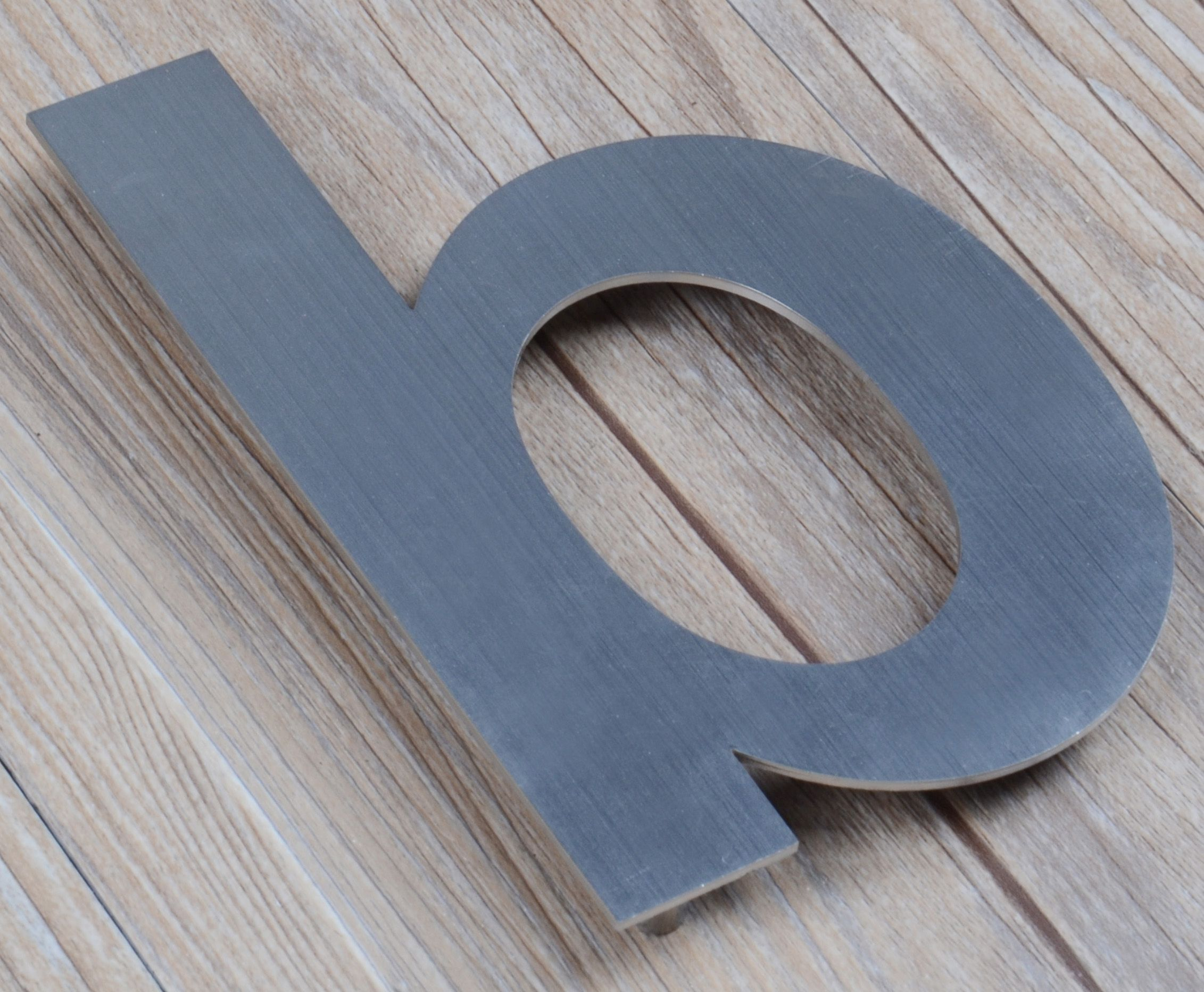 Sleek. Modern. Easy installation.  QT Home Decor Floating House Letters.