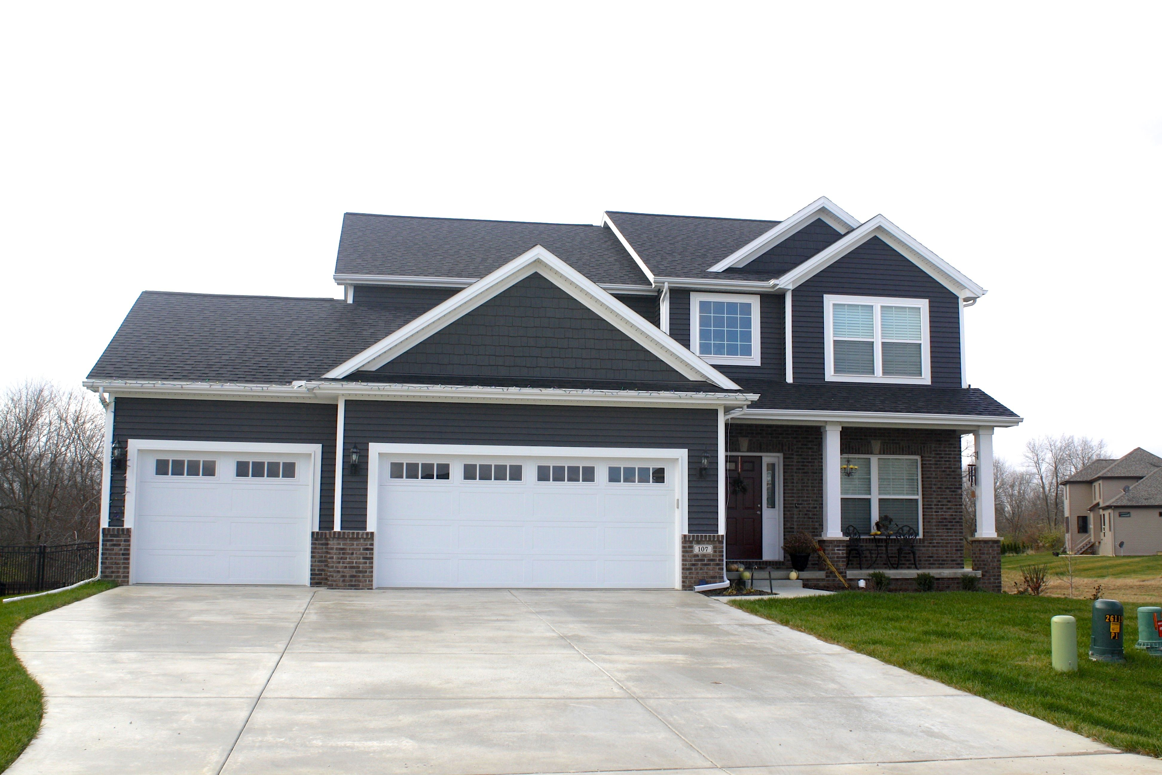 White Trim Royal Ironstone Dark Grey Siding And Shakes White Carriage Style Garage Doors Certainteed Moire Black Roof In Downs Il In 2020 Carriage Style Garage Doors Gray House Exterior House Paint Exterior
