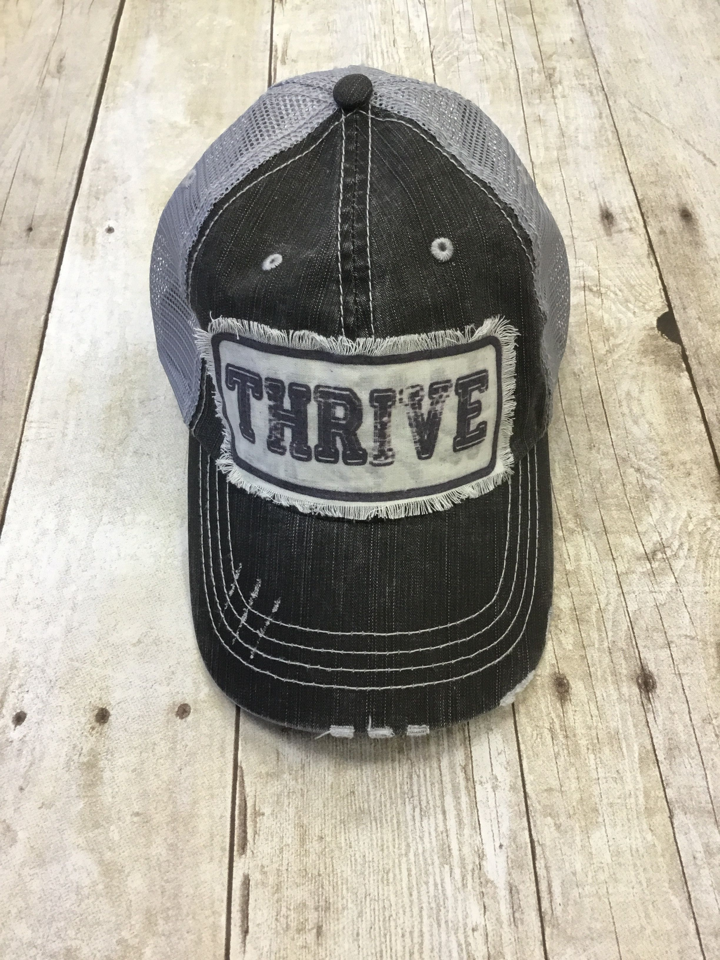 on sale f2760 8eeba Thrive Trucker Hat
