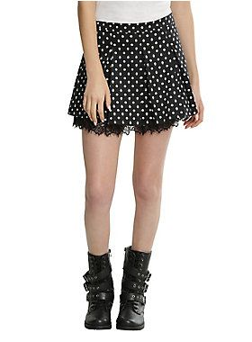"""A classic print gets an edgy upgrade on this super cute fit and flare skirt. Black and white skull and polka dot print pleated skirt with a black lace peek-a-boo underskirt. Side zipper closure.<div><ul><li style=""""list-style-position: inside !important; list-style-type: disc !important"""">98% cotton; 2% spandex</li><li style=""""list-style-position: inside !important; list-style-type: disc !important"""">Hand wash cold; dry flat</li><li style=""""list-style-position: inside !important; list-style-type…"""