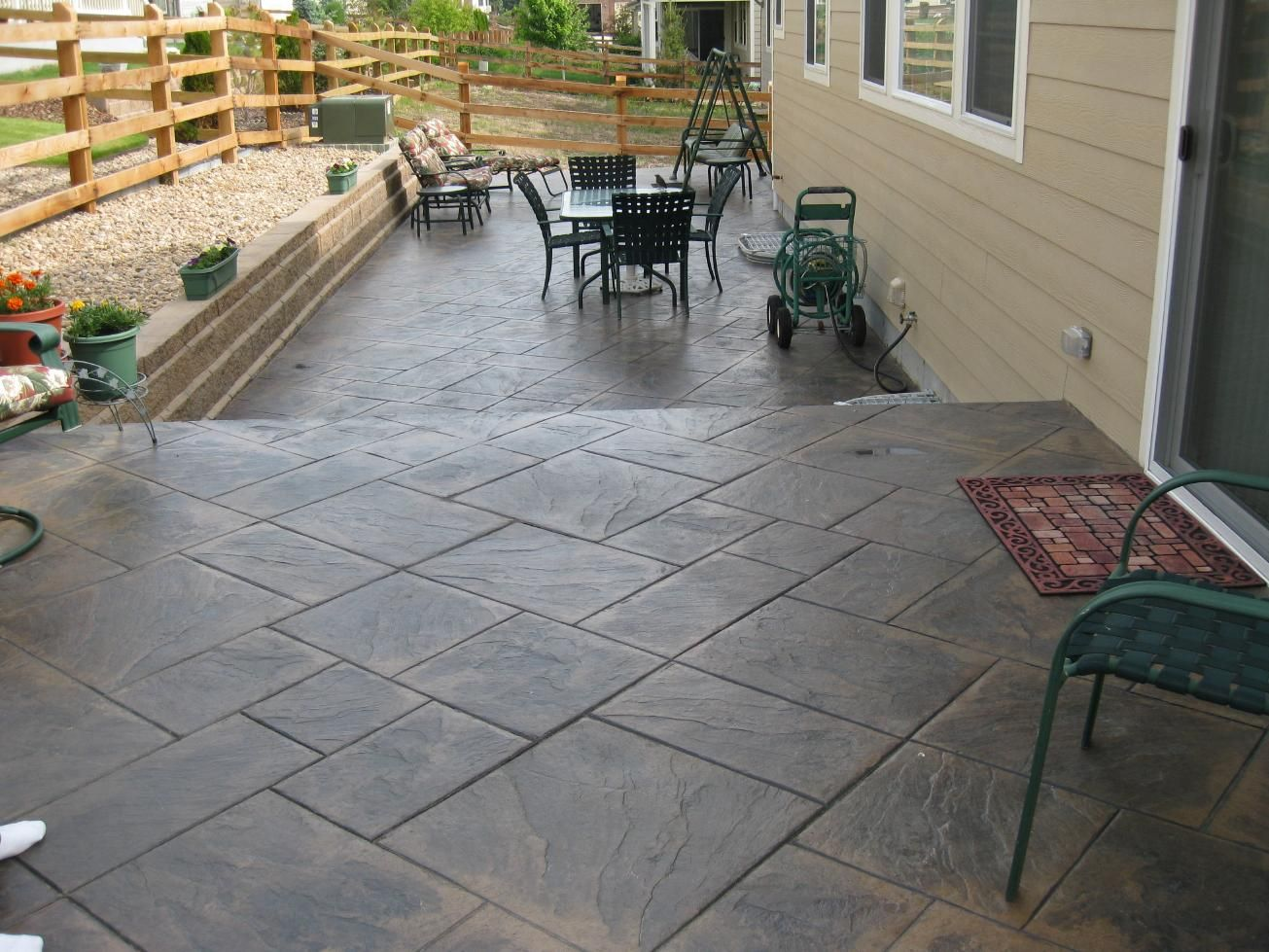 stamped concrete under deck patio | Decks | Take a Walk Down Briar Street