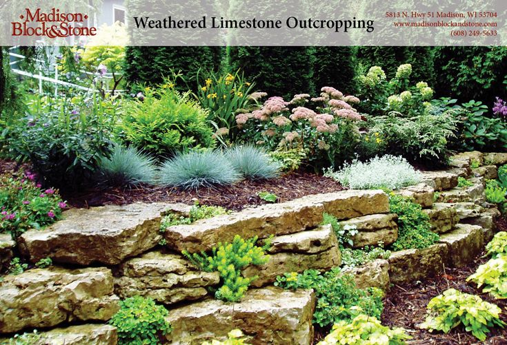 weathered edge limestone outcroppings are strategically placed to