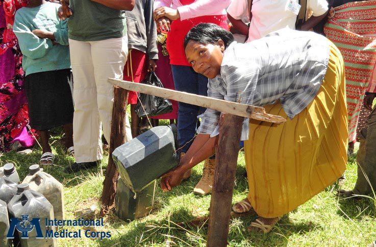 June 4: A woman at a hand-washing station in Laikipia, Kenya Photo: Alexandra Rutishauser-Perera, International Medical Corps, Kenya 2012