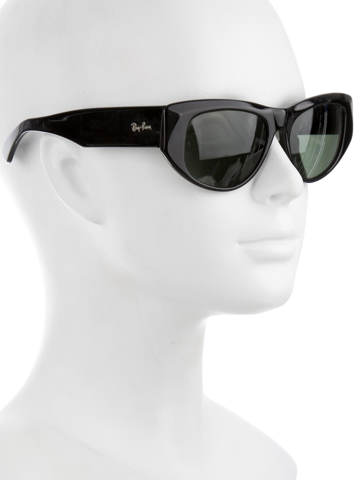 Black resin Ray-Ban cat-eye sunglasses with green lenses, textured accents  at frames and silver-tone logo details at temples. Includes case. 42c4e94815