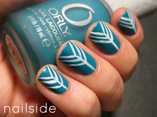Blue nails with white arrows by Nailside