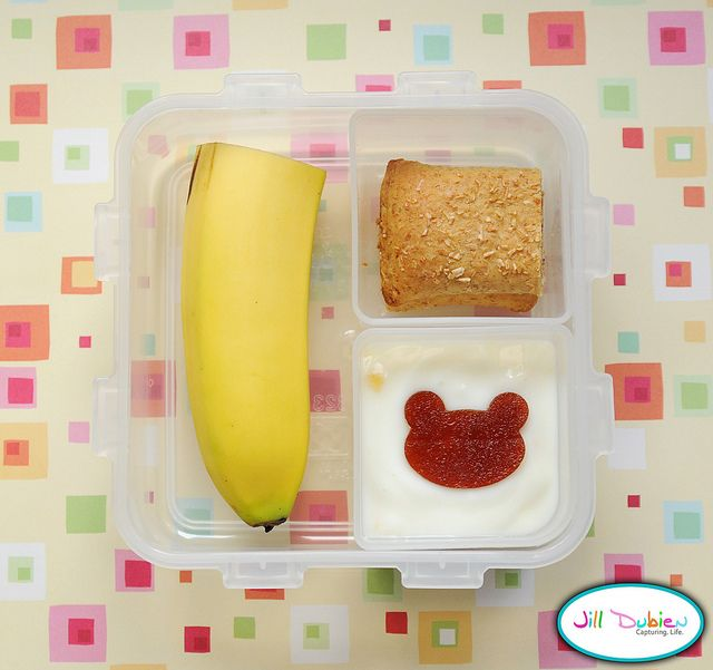 Love this kids bento idea for young kids featuring half a banana, a Nutrigrain bar cut in half, and yogurt topped with a cute fruit leather bear. (Making a slice in backside of the banana will make it easier for little fingers to peel.) Thanks to Jill Dubien for the idea!