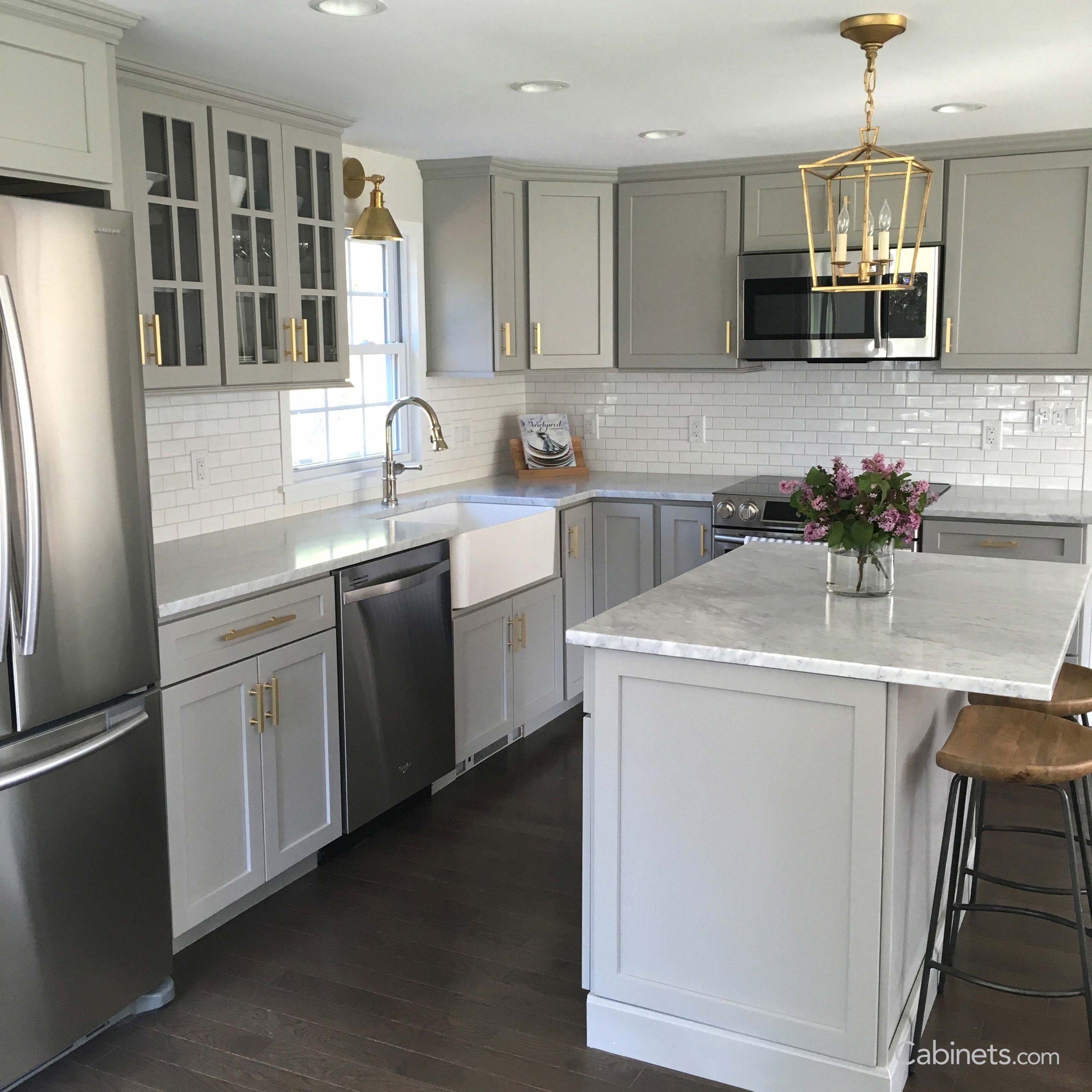 Classic Style Light Gray Kitchen With Muted Gold Hardware Cabinets Com Cabinetscom Classic Gold G In 2020 Light Grey Kitchens Kitchen Remodel Small Kitchen Design