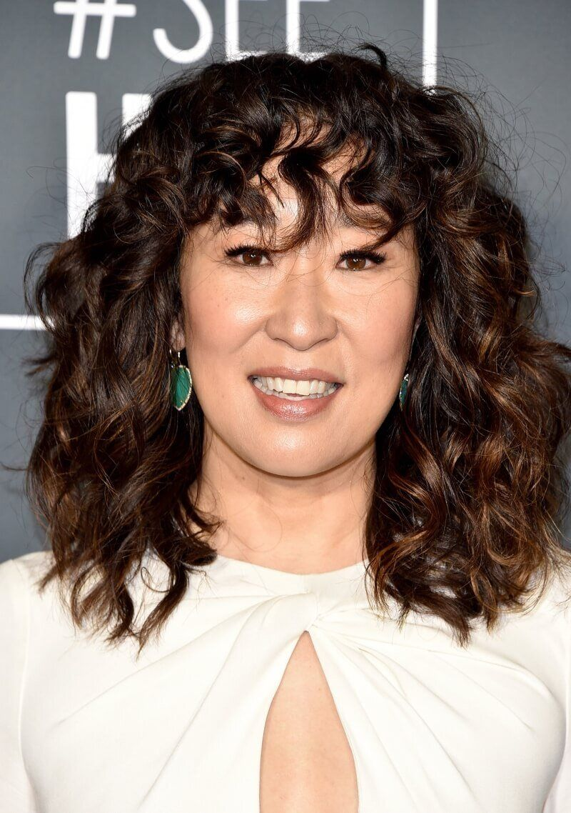 21 Curly Bangs Hairstyle Ideas Seen On Celebs Who Refuse To Tame The Mane I Am Co In 2020 Curly Hair Styles Hairstyles With Bangs Long Face Hairstyles
