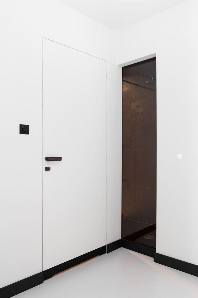Rahmenlose Tür-Einbau Konzept-moderne Wohnung-Kasia Orwat - heizkorper modern wohnzimmer