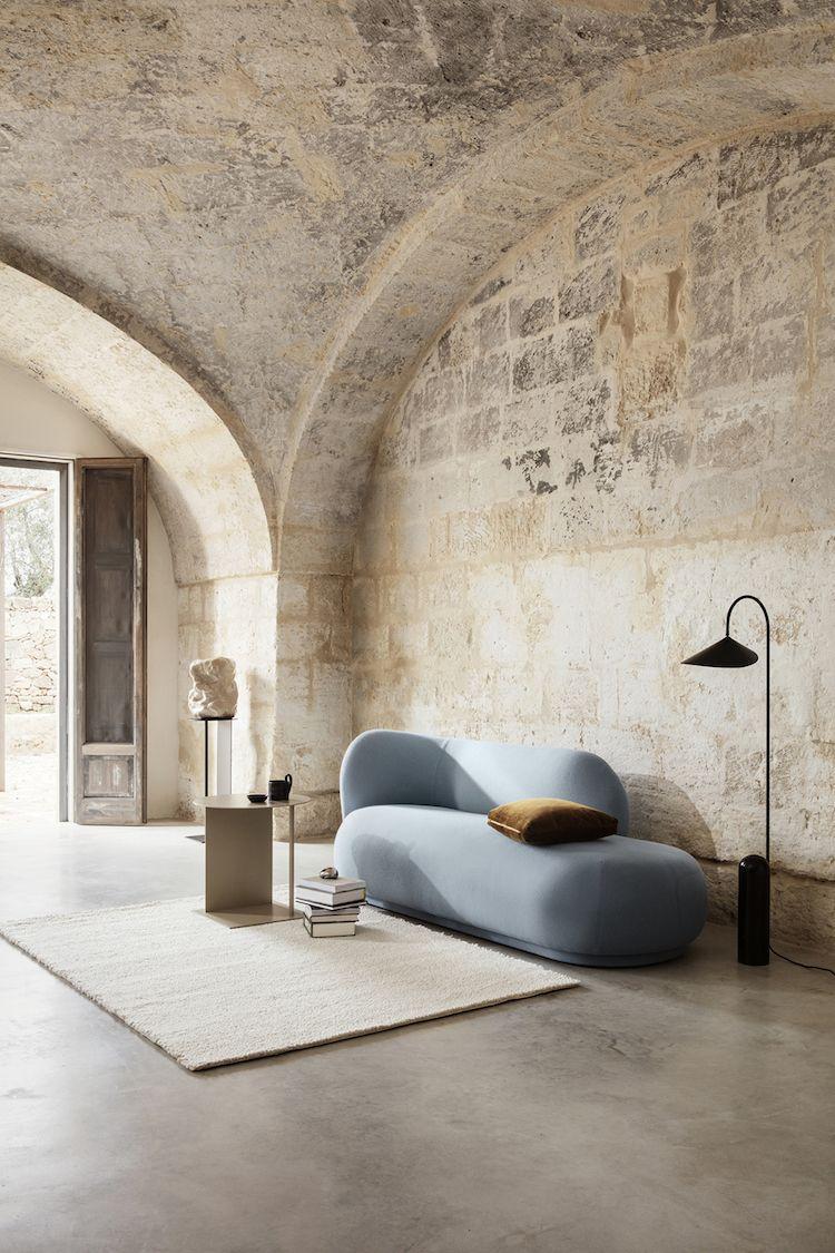 Photo of Sky blue sofa / brown cushion