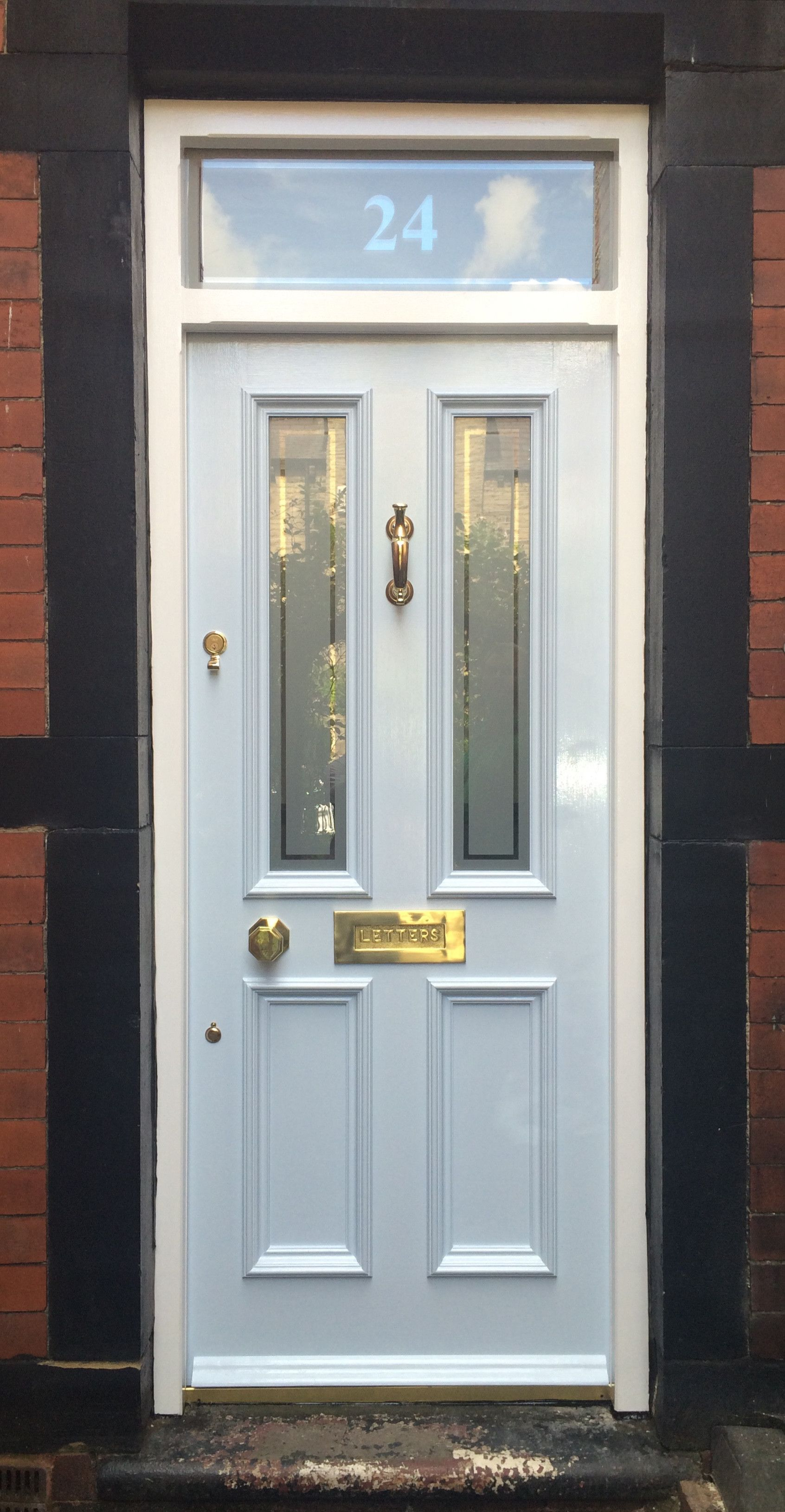 Fanlight frame and grand victorian front door with etched glazing and numbered fanlight in barnsley