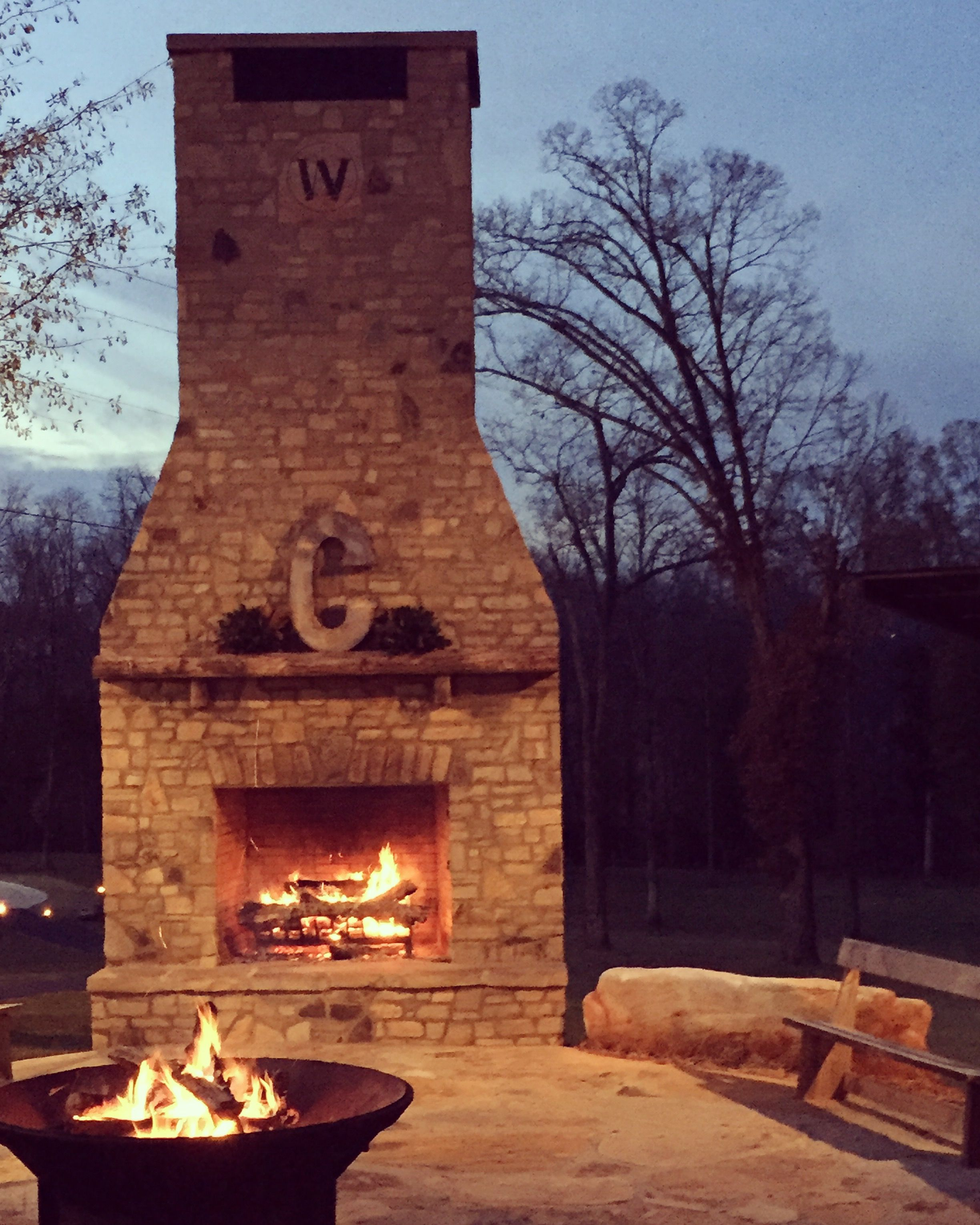 Wedding outdoor fireplace at our barn wedding venue in