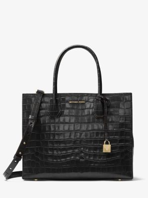 Crafted from crocodile-embossed leather, this textured accessory ...