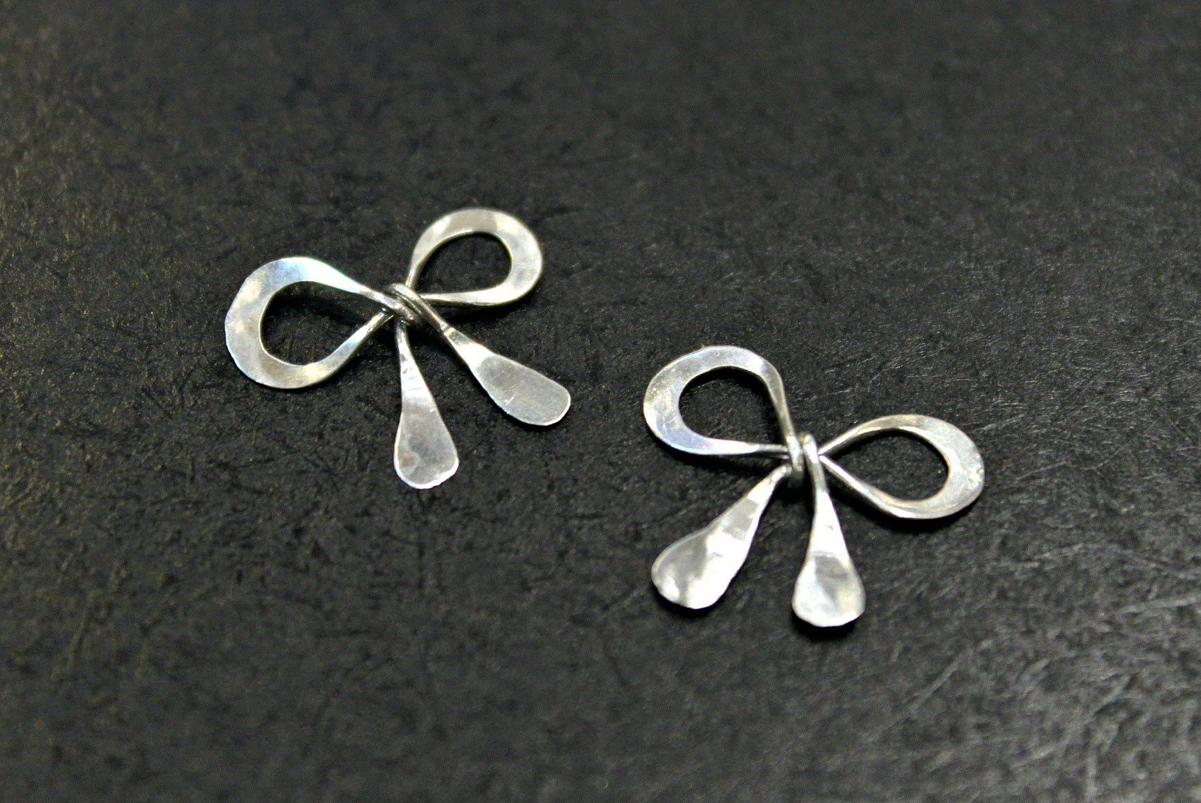 How to make a silver wire wrapped bow charm - video of pictures ...