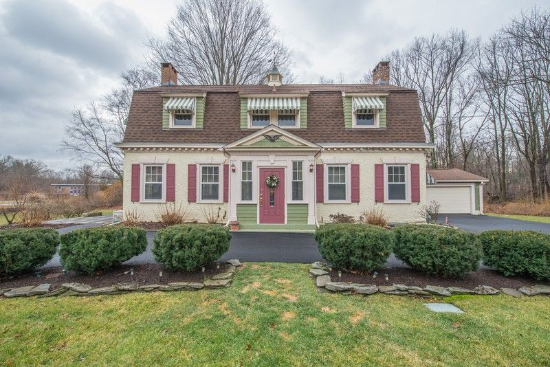 Stately Historic Dutch Colonial Revival 12 room Manor Home
