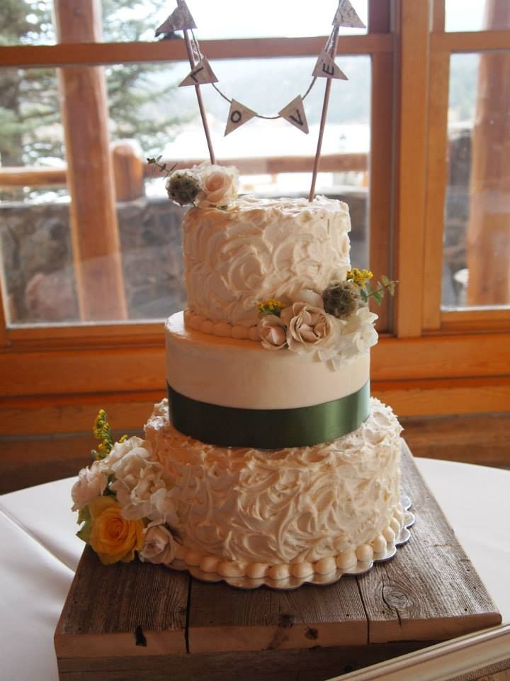 My First Wedding Cake #rusticweddingcake #buntingweddingcake #creamcheesefrostingweddingcake