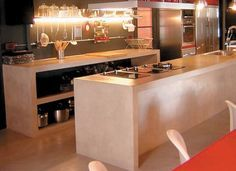 10 estilos de cocina con cemento alisado