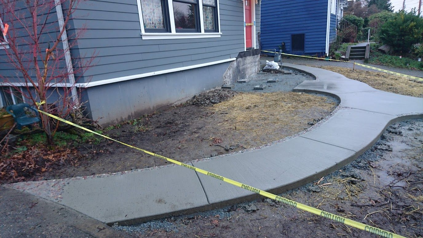 New Concrete Path With Stone Inlays Poured Concrete