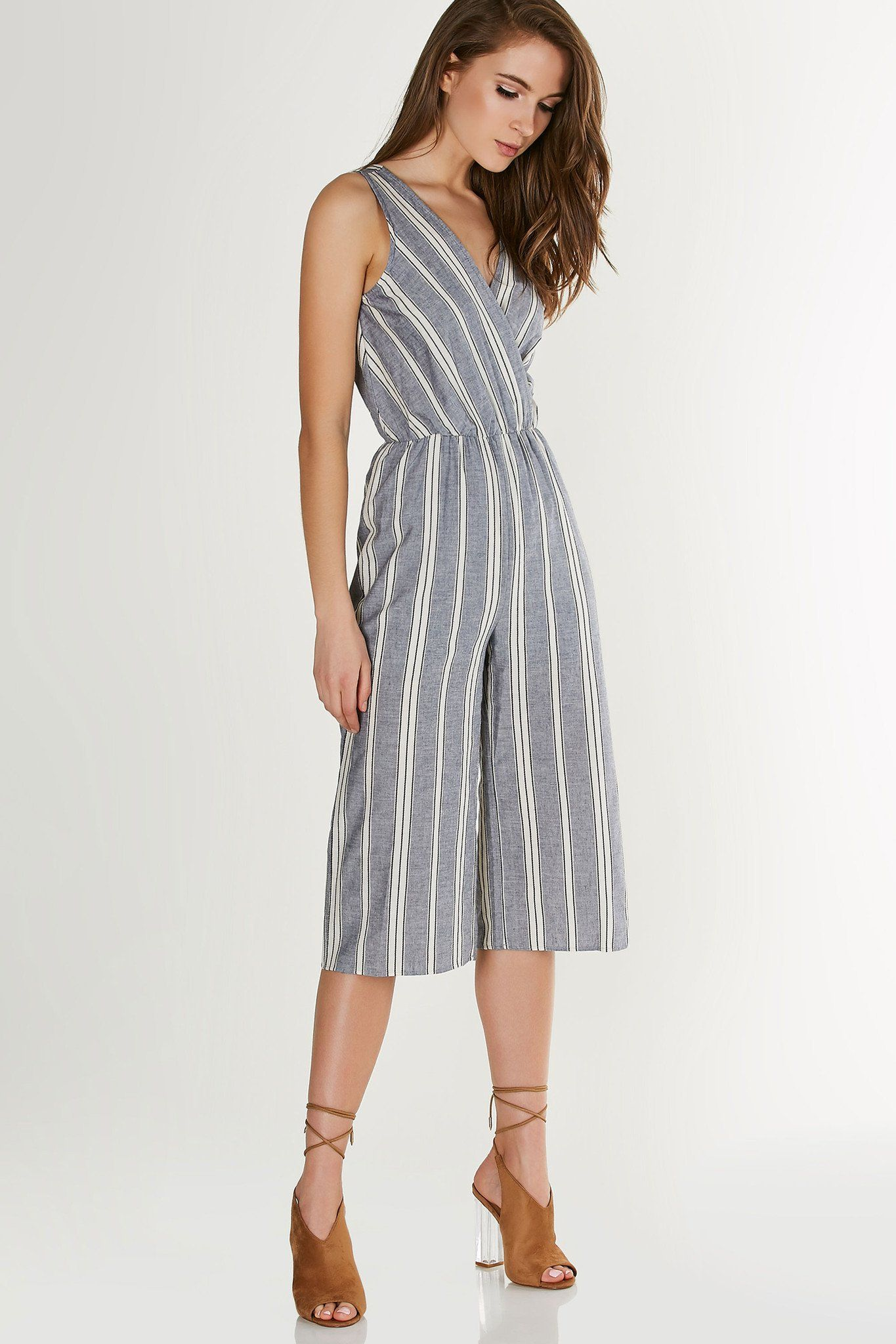 99d76b1843d Chic sleeveless jumpsuit with stripe patterns throughout. Overlap neckline  with elasticised waist and straight leg fit.
