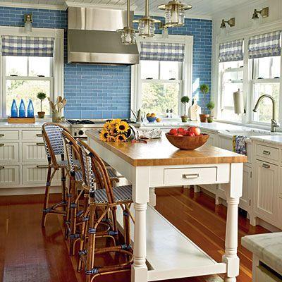 Coastal Living Kitchen Decor. Blinds up, colored bottles, fresh flowers, bowls of fruit!