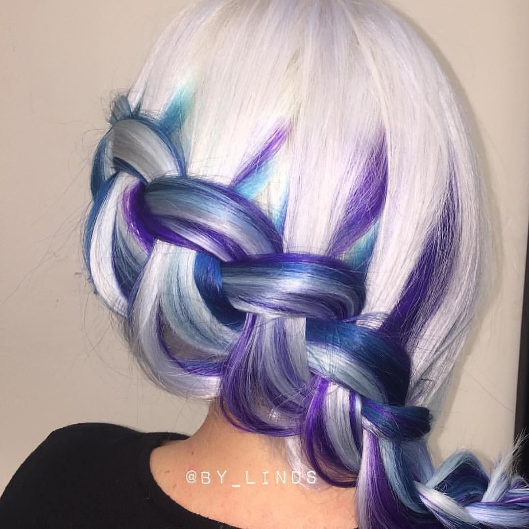 We love this icy color design and braided style by bylinds hair