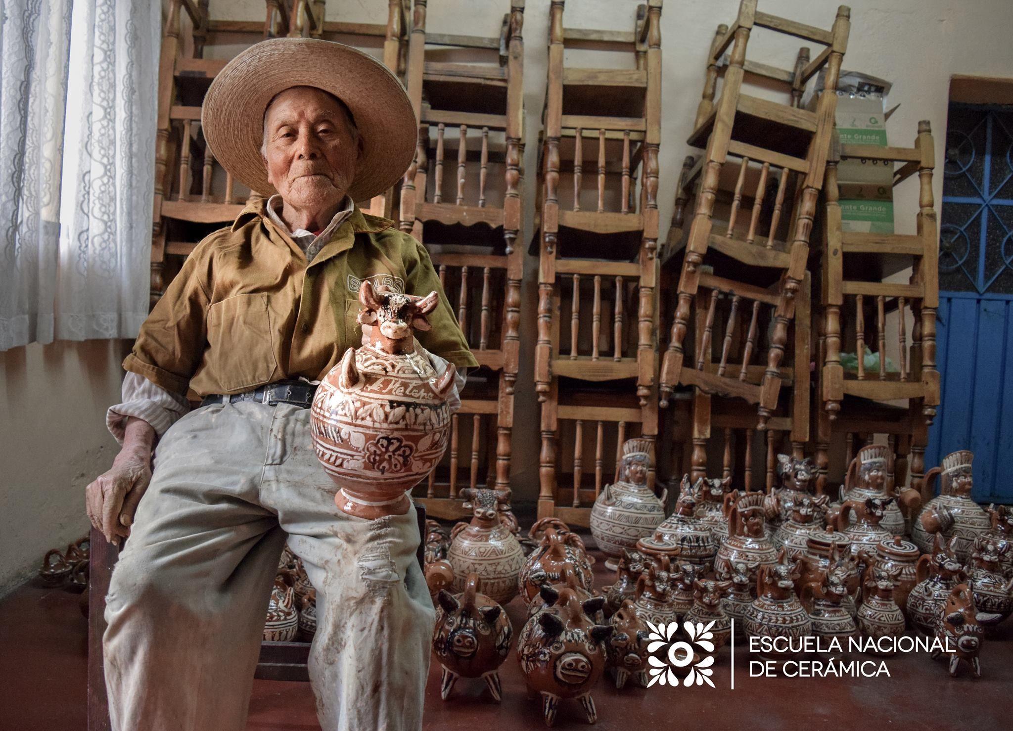 Master ceramic artist Irma Garcia Blanco stands between