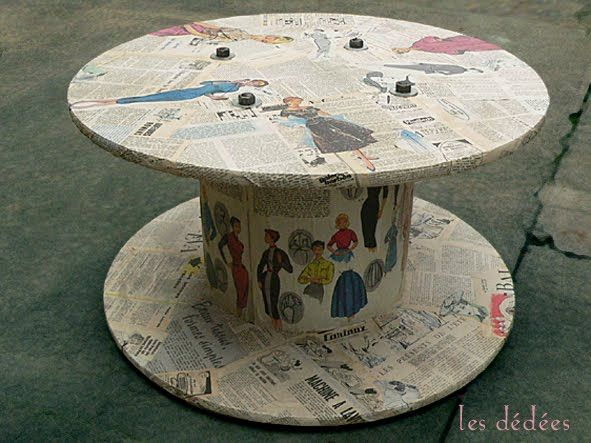 Wood cable spool reel table covered with magazine cut outs for Wooden cable reel ideas