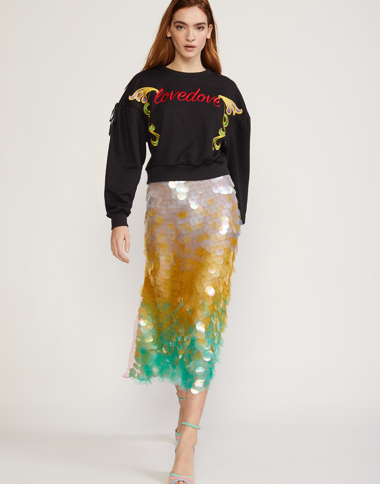 4f37e9a1ec Front view of model walking in iridescent sequin skirt with ombre cascading  pailletes.