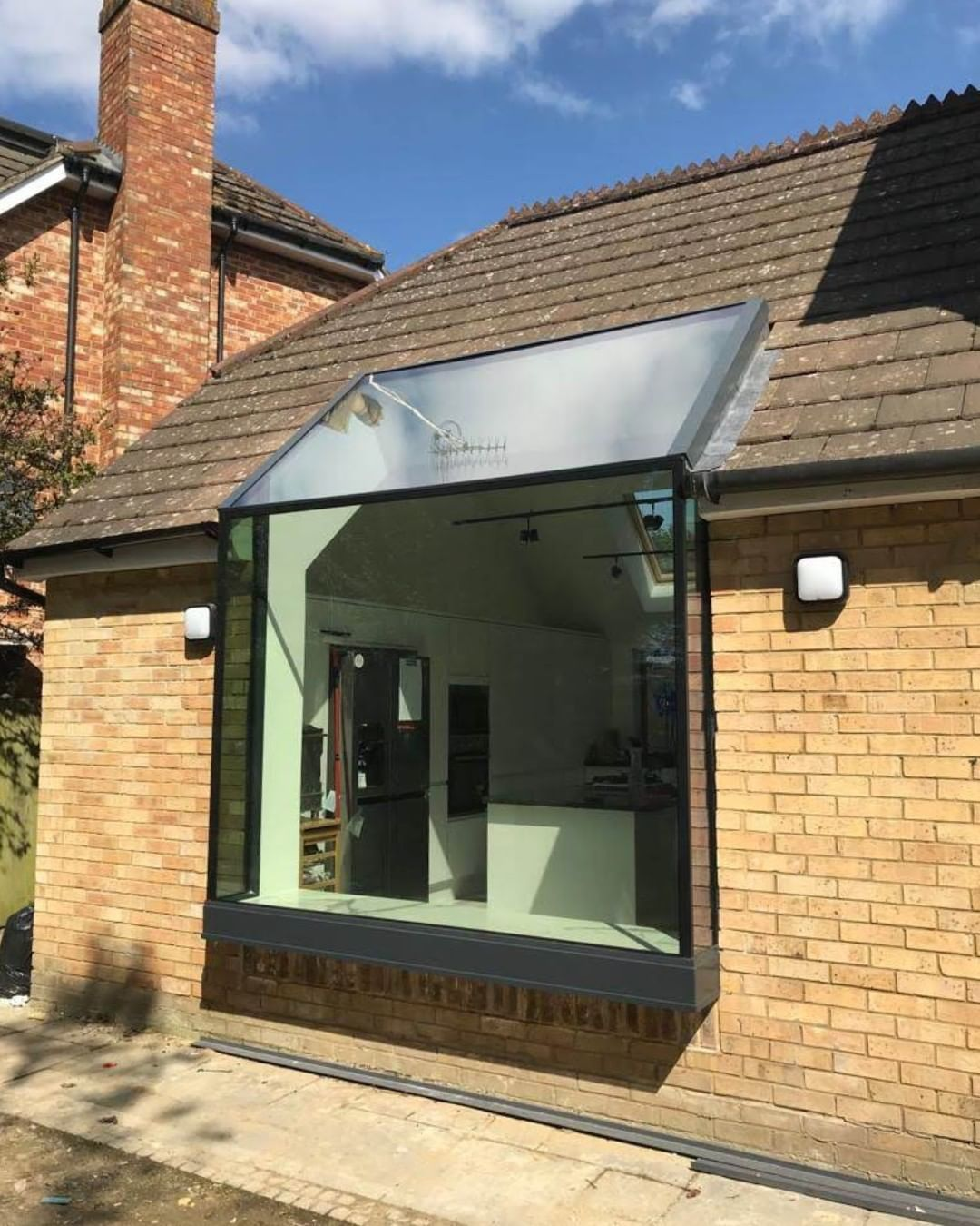1st Folding Sliding Doors On Instagram Stunning Frameless Glass Up And Over Roof Connected Bay Window Exterior House Extension Design Small House Extensions