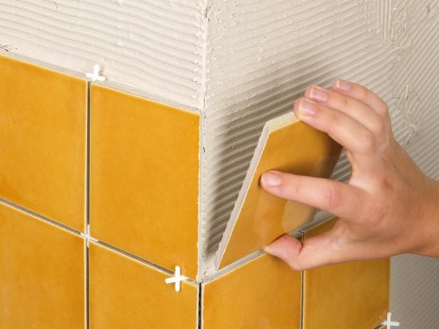 How To Install Tile On A Bathroom Floor Diy Wall Tile Tile Installation Bathroom Flooring