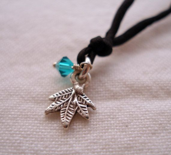 Sterling silver maple leaf charm on black silk yoga necklace by honeywild, $42.00