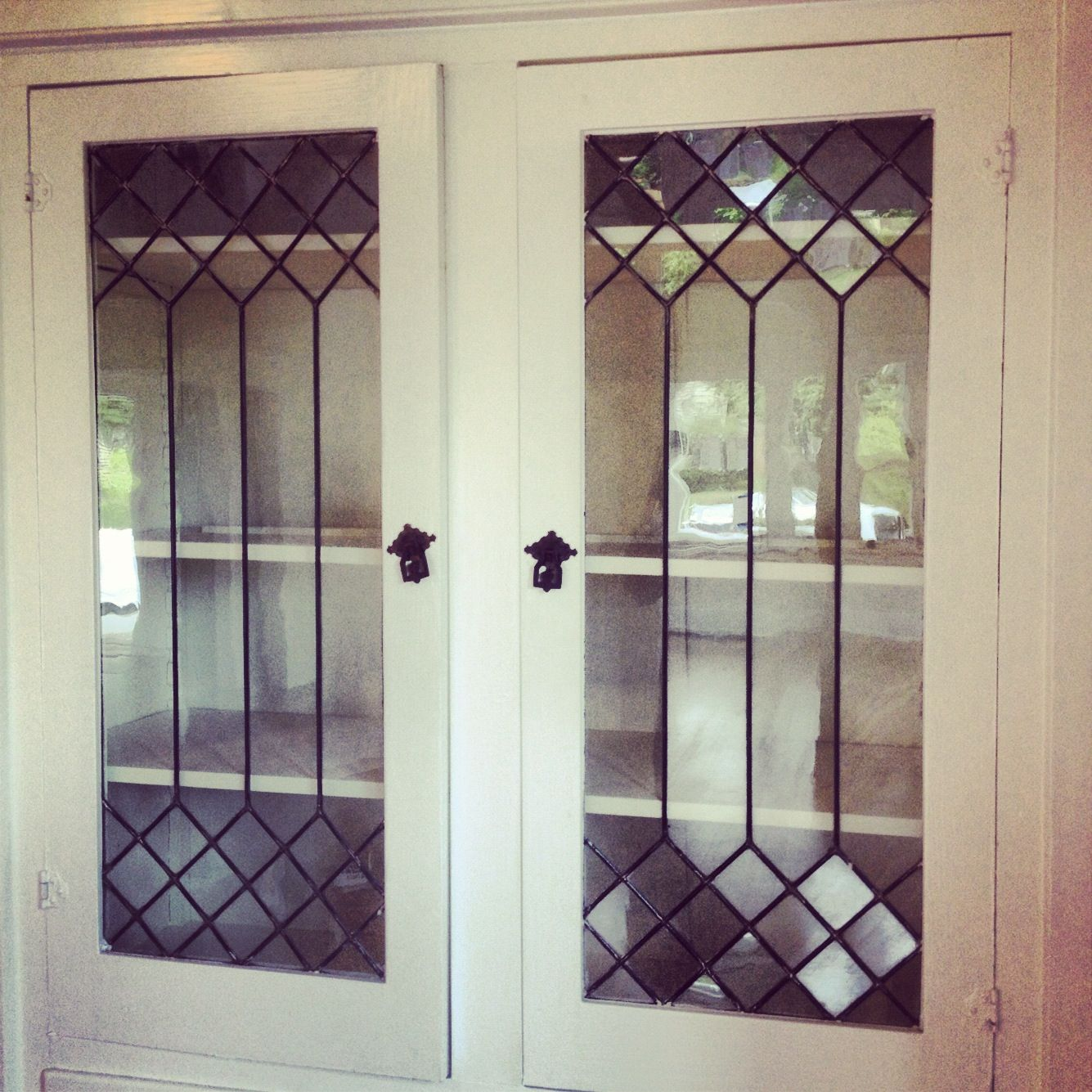 Leaded glass doors on built in Glass doors