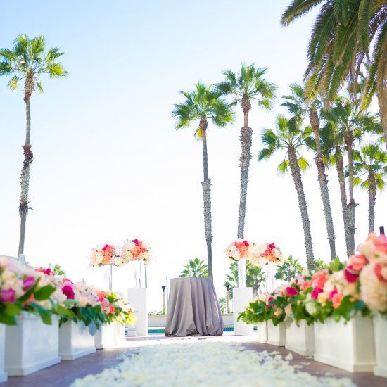 This fun SoCal couple met down an aisle lined with dozens of bright pink and captivating orange arrangements by Flowers by Cina